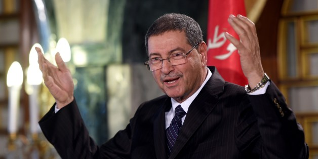 Tunisia's nominated Prime Minister Habib Essid announces a new cabinet ministers list after presenting the list to the Tunisia's President Beji Caid Essebsi during a press conference at Carthage Palace in Tunis on January 23, 2015. Essid presented a government representing what he said were 'national skills', excluding the Islamist Ennahda party from the list, however he must obtain the confidence of the Parliament before they take office. AFP PHOTO / FETHI BELAID