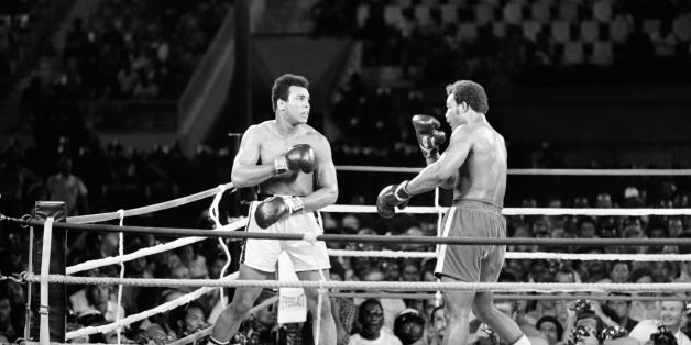 In this photo taken on October 30, 1974 shows the fight between US boxing heavyweight champions, Muhammad Ali (L) (born Cassius Clay) and George Foreman in Kinshasa. On October 30, 1974 Muhammad Ali knocked out George Foreman in a clash of titans known as the 'Rumble in the Jungle', watched by 60 000 people in the stadium in Kinshasa and millions elsewhere. AFP PHOTO        (Photo credit should read STR/AFP/Getty Images)