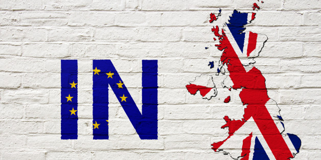 Brexit: Map of the United Kingdom and the word 'In' suggesting the UK remains within the European Union painted onto a white brick wall