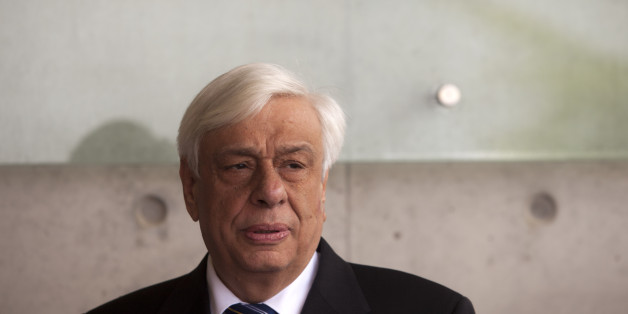 Greek President Prokopis Pavlopoulos visits the Holocaust memorial Yad Vashem in Jerusalem, Wednesday, March 30, 2016. (AP Photo/Dan Balilty)
