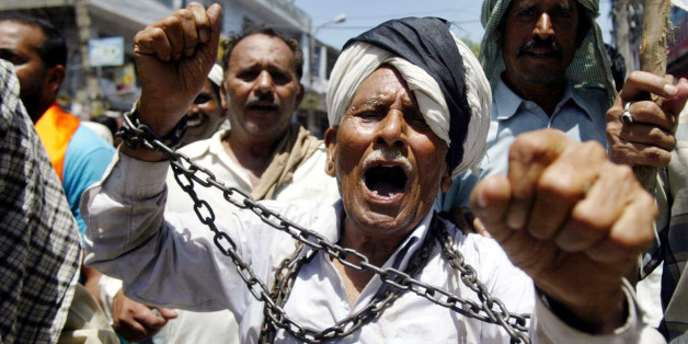 "West Pakistani refugees shout slogans against the Indian government protesting discrimination in Jammu, India, Wednesday, Aug. 15, 2007. The West Pakistani Refugee Action Committee has decided to observe Indian Independence Day as ""Black Day"" for their community, as their community is still allegedly living the life of the slaves in independent India. (AP Photo/Channi Anand)"