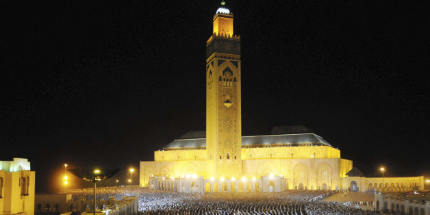 Moroccan faithful pray on the esplanade of the Hassan II Mosque on Laylat al-Qadr during the holy month of Ramadan, in Casablanca August 15, 2012. Laylat al-Qadr (Night of Decree) is the anniversary of the night Muslims believe the Koran was revealed to Prophet Mohammad by the angel Gabriel. Picture taken August 15, 2012. REUTERS/Youssef Boudlal (MOROCCO - Tags: RELIGION SOCIETY)