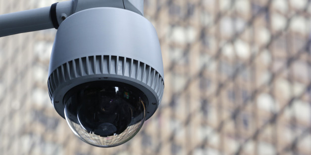 A security camera, center, is mounted on the side of a building overlooking an intersection in midtown Manhattan, Wednesday, July 31, 2013 in New York. (AP Photo/Mark Lennihan)