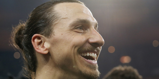 Football Soccer - Olympique Marseille v Paris St Germain - France Cup Final - Stade de France, Saint-Denis, France - 21/05/2016.  Paris St Germain's Zlatan Ibrahimovic reacts after winning the trophy in their French Cup final soccer match.    REUTERS/Gonzalo Fuentes