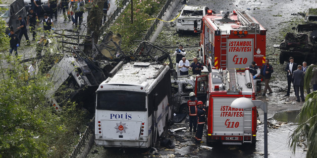Fire engines stand beside a Turkish police bus which was targeted in a bomb attack in a central Istanbul district, Turkey, June 7, 2016.    REUTERS/Osman Orsal