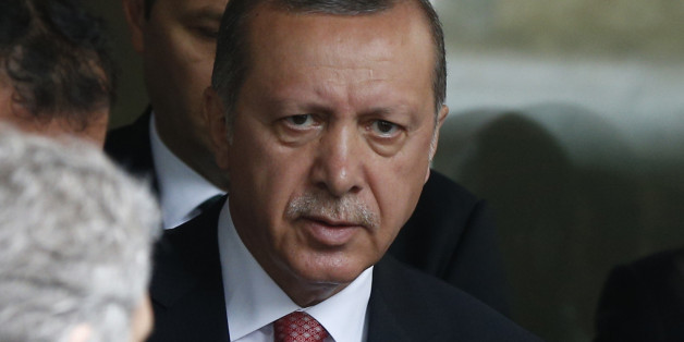 Turkey's President Recep Tayyip Erdogan walks outside a hospital after visiting wounded people, near an explosion site in Istanbul, Tuesday, June 7, 2016. A car bomb attack targeting a bus carrying riot police during rush hour traffic in Istanbul on Tuesday has killed number of people and wounded dozens others, the city's governor said. (AP Photo/Lefteris Pitarakis)