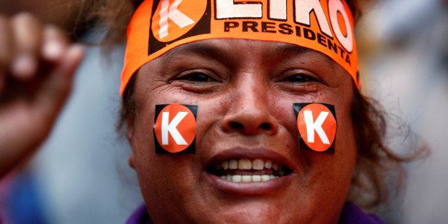 A woman wears a headband with the name of Peruvian presidential candidate Keiko Fujimori in Lima, Peru, June 5, 2016. REUTERS/Janine Costa