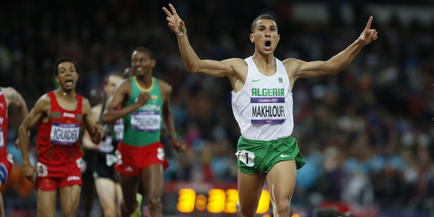 Algeria's Taoufik Makhloufi (front) celebrates as he wins the men's 1500m final during the London 2012 Olympic Games at the Olympic Stadium August 7, 2012. REUTERS/Lucy Nicholson (BRITAIN  - Tags: SPORT ATHLETICS OLYMPICS)