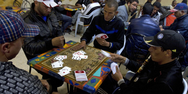 Locals youths play cards at a coffee shop, in the town of Sidi Bouzid,Tunisia, Tuesday March 8, 2011. Sidi Bouzid, is the hometown of Mohamed Bouazizi, the local fruit vendor and high-school dropout who set himself on fire Dec. 17, in a desperate act that set off mass protests that brought down Tunisian President Zine El Abidine Ben Ali in less than a month. The revolt inspired others who toppled autocratic Egyptian President Hosni Mubarak, launched an armed rebellion against Libyan despot Moamm