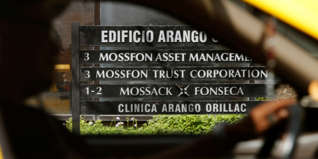 A taxi pass a company list showing the Mossack Fonseca law firm at the Arango Orillac Building in Panama City May 9, 2016. The International Consortium of Investigative Journalists will release on May 9 a database with information on more than 200,000 offshore entities that are part of the Panama Papers investigation, according to local media. REUTERS/Carlos Jasso