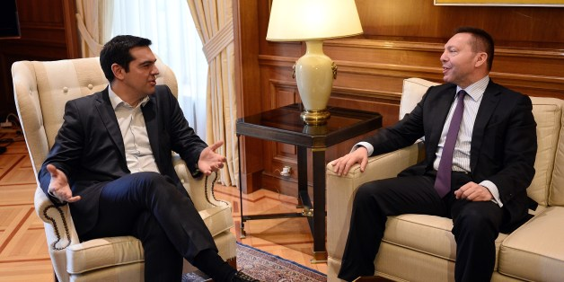 Greece's prime minister Alexis Tsipras (L) talks with the chairman of the Bank of Greece, Yiannis Stournaras during their meeting in Athens on March 6, 2015 after Athens got no help from the European Central Bank to address a cash squeeze.  The ECB recently cut off a key channel of financing for Greek banks, saying it would no longer accept Greek sovereign bonds as collateral for loans. Greek Prime Minister Alexis Tsipras has requested a meeting with European Commission chief Jean-Claude Juncker