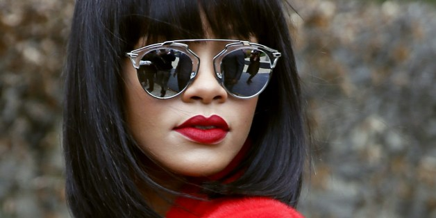 Barbadian singer Rihanna poses as she arrives to attend Christian Dior 2014  2015 Autumn  8f477064ab5c