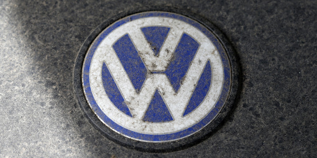 A Volkswagen (VW) logo is seen on a car engine at a scrapyard in Fuerstenfeldbruck, Germany, May 21, 2016.    REUTERS/Michaela Rehle