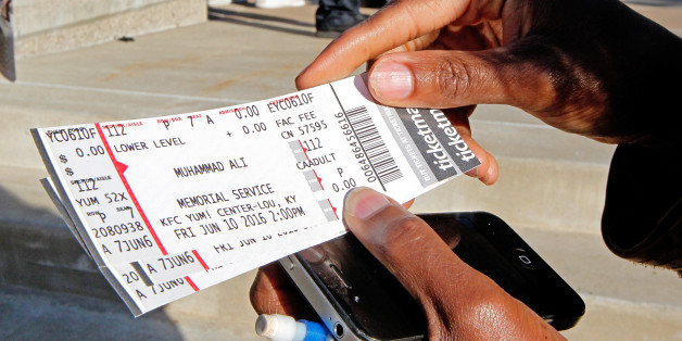 Fay Brents looks over her four tickets to Muhammad Ali's Friday memorial service at the KFC Yum! Center in Louisville, Kentucky, U.S. June 8, 2016. REUTERS/John Sommers II