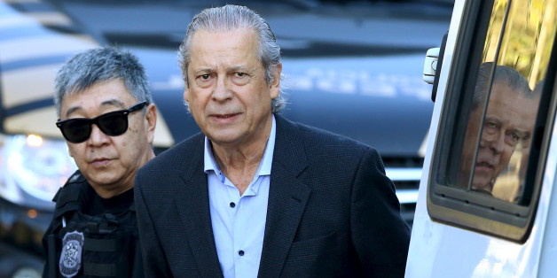 Jose Dirceu (R), former Brazilian President Luiz Inacio Lula da Silva's chief of staff, is escorted by federal police officer Newton Ishii as he leaves the Federal Police headquarters to give his testimony in a session of the Parliamentary Committee of Inquiry in Curitiba, Brazil, August 31, 2015. Brazilian police on August 3 arrested former government minister Dirceu, one of the most senior members of the ruling Workers' Party to be detained so far in the corruption scandal engulfing state-run