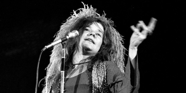Rock concert replace Met fans at Shea Stadium. A 12-hour 'summer festival for peace,' sponsored by Peace Inc., bombarded hip music buffs with amply-amplified rock musc. Rock singer Janis Joplin, demanding lights out for performance, does her thing. (Photo By: /NY Daily News via Getty Images)