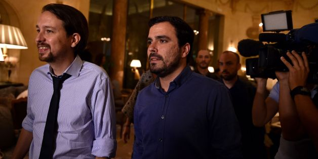Leader of left wing party Podemos Pablo Iglesias (L) and leader of Izquierda Unida IU  (United Left) Alberto Garzon arrive at the Ritz Hotel prior to an economic forum on June 6, 2016 in Madrid, four days ahead of the start of the electoral campaign. Podemos, a close ally of Greece's ruling Syriza party, in May formed an alliance with Izquierda Unida, a coalition led by the countrys communist party, to run together in the June 26 elections. / AFP / GERARD JULIEN        (Photo credit should read GERARD JULIEN/AFP/Getty Images)