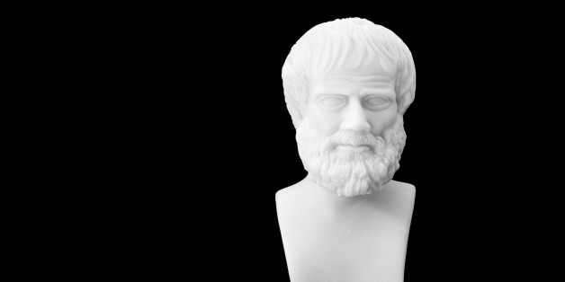 Greek philosopher Aristotle (384-322 B.C.E.) sculpture isolated on black background