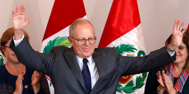 Peruvian presidential candidate Pedro Pablo Kuczynski, greets the press after Peru's electoral office ONPE said that he won more votes than Keiko Fujimori in the country's cliffhanger presidential election in his headquarters in Lima, Peru, June 9, 2016.  REUTERS/Janine Costa