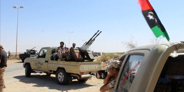 Forces aligned with Libya's new unity government are seen on the road as they advance on the eastern and southern outskirts of the Islamic State stronghold of Sirte, in this still image taken from video on June 9, 2016. via Reuters TV