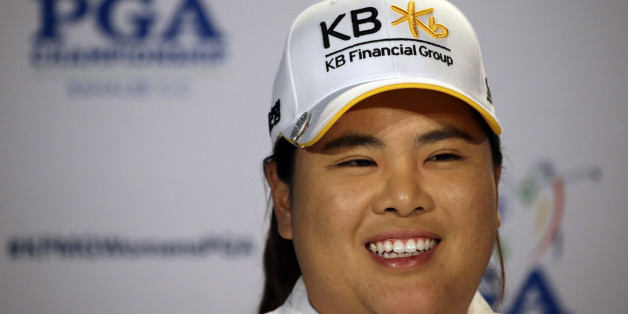 Inbee Park, of South Korea, begins to address a news conference after finishing the first round at the Women's PGA Championship golf tournament at Sahalee Country Club Thursday, June 9, 2016, in Sammamish, Wash. With the completed round, Park becomes eligible for the LPGA Hall of Fame. (AP Photo/Elaine Thompson)