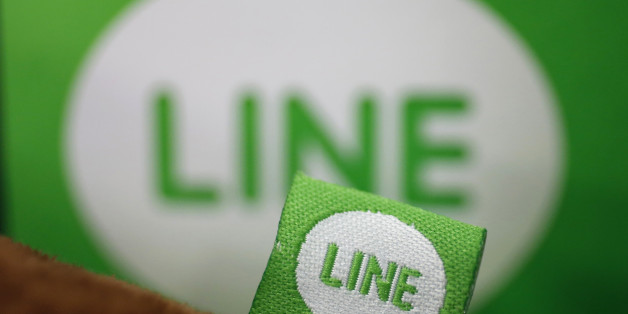 The logo of free messaging app Line is pictured on a smartphone and the company's stuffed toy in this photo illustration taken in Tokyo September 23, 2014. Naver Corp held off on an IPO for its Line Corp unit on the belief that the messaging app operator can command a better valuation by further building its revenue and profit, Naver's chief financial officer told Reuters on Tuesday. South Korea-based Naver said on Monday that it does not plan an initial public offering for Line this year, dashi