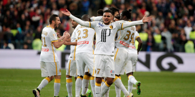 Lille's Sofiane Boufal, center, celebrates after team mate Djibril Sidibe scored a goal, during the League Cup final soccer match between Paris Saint Germain and Lille, at the Stade de France stadium, in Saint Denis, north of Paris, Saturday, April 23, 2016. (AP Photo/Thibault Camus)