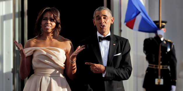 U.S. President Barack Obama and First Lady Michelle Obama react while waiting for the arrival of the Iceland Prime Minister Sigurdur Ingi Johannsson and his wife at a state dinner in the White House during the U.S.-Nordic Leaders Summit in Washington, U.S. May 13, 2016. REUTERS/Carlos Barria