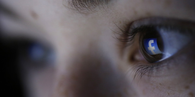 A picture illustration shows a Facebook logo reflected in a person's eye, in Zenica, March 13, 2015. Facebook Inc recorded a slight increase in government requests for account data in the second half of 2014, according to its Global Government Requests Report, which includes information about content removal. Requests for account data increased to 35,051 in the second half of 2014 from 34,946 in the first half, with requests from countries such as India rising and those from others including Uni