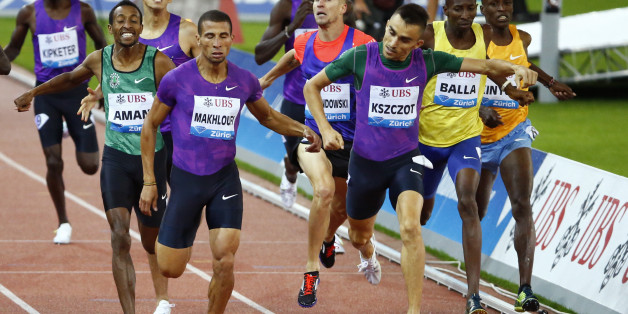 Adam Kszczot of Poland and Taoufik Makhloufi of Algeria cross the finish line in the men's 800m event at the IAAF Athletics Diamond League meeting in Zurich September 3, 2015.  REUTERS/Ruben Sprich