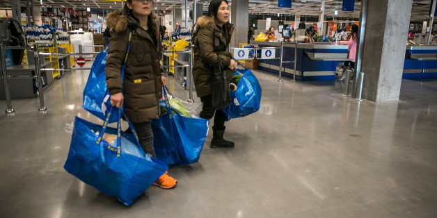 Customers carrying Ikea AB shopping bags leave the company's store in Gwangmyeong, Gyeonggi province, South Korea, on Thursday, Dec. 18, 2014. Ikea, the world's largest home-furnishings retailer, opened its first store in South Korea. Photographer: Jean Chung/Bloomberg via Getty Images