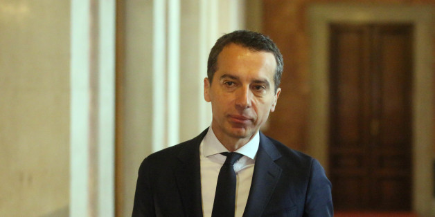 New Austrian Chancellor Christian Kern leaves a government meeting at the parliament in Vienna, Austria, Wednesday, May 18, 2016. (AP Photo/Ronald Zak)
