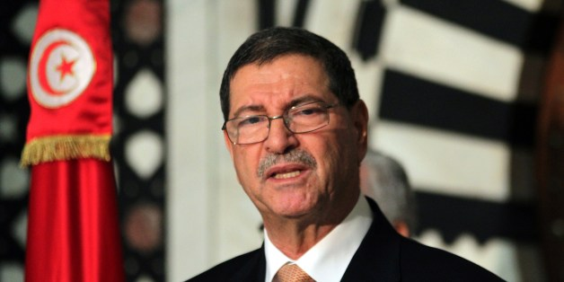 Tunisian Prime Minister Habib Essid speaks during a press conference after an attack carried out by two gunmen at Bardo International Museum on March 18, 2015 in Tunis. At least 17 foreigners were killed, they were among 19 people who died in the attack by two men armed with assault rifles on the museum, the interior ministry said. AFP PHOTO / ARBI SOUSSI        (Photo credit should read ARBI SOUSSI/AFP/Getty Images)