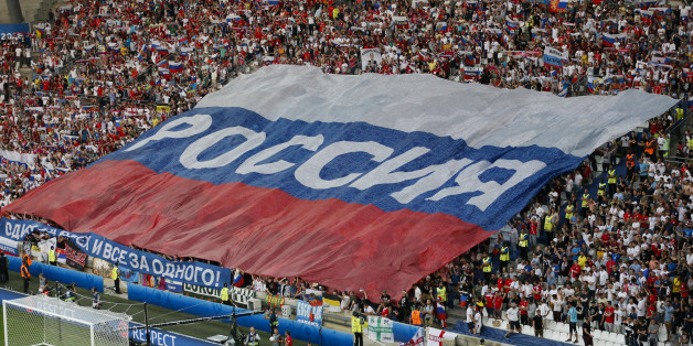 Football Soccer - England v Russia - EURO 2016 - Group B - Stade Velodrome, Marseille, France - 11/6/16 - Russian team supporters stretch giant Russian flag in the stands.   REUTERS/Robert Pratta