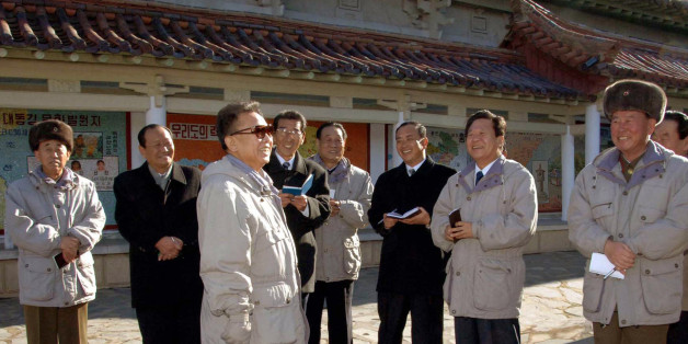 In this photo released on Friday, Dec. 12, 2008, by the official (north) Korean Central News Agency via Korea News Service in Tokyo without mentioning the exact date when it was taken, North Korean leader Kim Jong Il, third left, visits the Folk Village with restaurants, an amusement park and a history exhibition area in Sariwon city, west of Pyongyang.  (AP Photo/Korean Central News Agency via Korea News Service) ** SOUTH KOREA OUT **