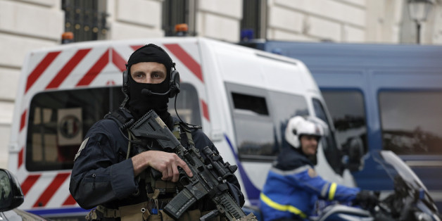 Members of French military task force GIGN secure the convoy transporting Paris attacks suspect, Salah Abdeslam as they leave the Paris courthouse, Friday, May 20, 2016. The last known survivor of the team that carried out last November's Paris attacks refused to talk during questioning Friday by anti-terror judges, and the session ended abruptly. (AP Photo/Laurent Cipriani)
