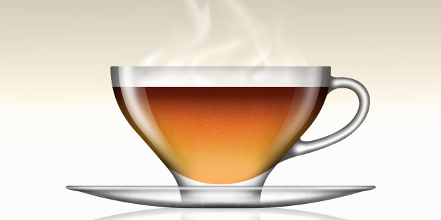 Earl Grey tea in glass teacup and saucer
