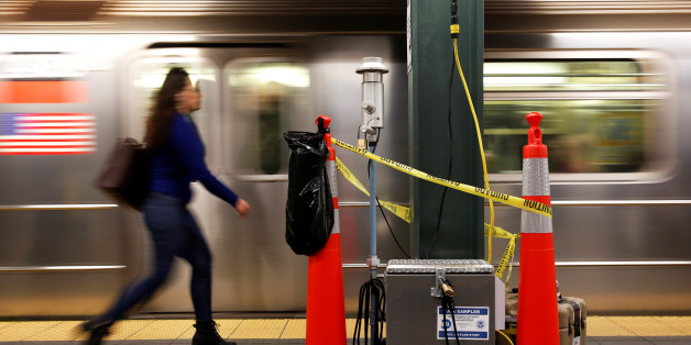 A woman walks by a device used for chemical tracers used by the Department of Homeland Security and New York Metropolitan Transportation Authority during a test of how gas would flow through the subway system in New York, U.S., May 9, 2016. REUTERS/Shannon Stapleton