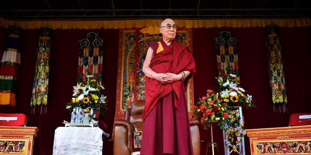 The Dalai Lama takes to the stage to address the faithful in Aldershot on June 29, 2015 which has a large Nepalese Buddhist community made up mainly of serving and retired Gurkha soldiers.  AFP PHOTO / BEN STANSALL        (Photo credit should read BEN STANSALL,BEN STANSALL/AFP/Getty Images)