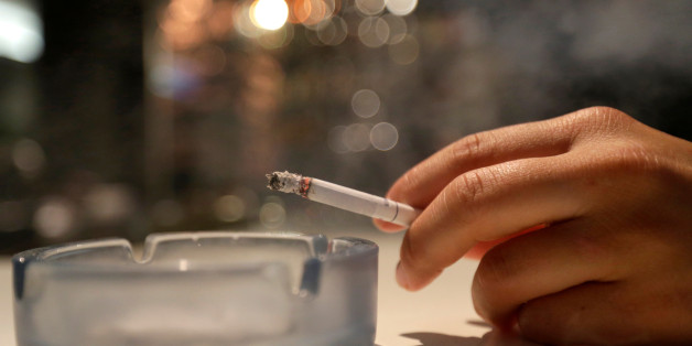 A customer smokes a cigarette in a cafe in Prague, Czech Republic, May 25, 2016. REUTERS/David W Cerny