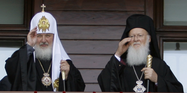 Newly elected Russian Orthodox Patriarch Kirill, left, and Istanbul Ecumenical Patriarch Bartholomew I gesture after they has led Sunday prayers in a show of unity at the patriarchal church of Aya Yorgi (St. George)in Istanbul, Turkey, Sunday, July 5, 2009. The churches in Istanbul and Moscow have been jostling for influence for years, but recently have pledged to overcome differences and achieve greater unity. Orthodox churches are largely autonomous, but the Istanbul-based Patriarchate is cons