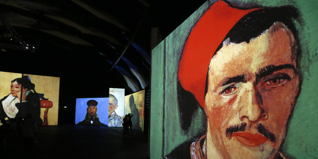 People visit the Van Gogh Alive exhibition in St. Petersburg, September 11, 2014. More than 3,000 images associated with the life and work of Van Gogh are on display during the exhibition.   REUTERS/Alexander Demianchuk (RUSSIA - Tags: ENTERTAINMENT SOCIETY)
