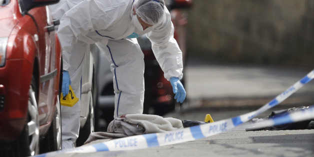 A forensics police officer works next women's shoes and a handbag on the ground behind a police cordon in Birstall near Leeds, June 16, 2016  A British lawmaker was in critical condition after an incident in her constituency in northern England on Thursday, British police said, with media reports suggesting she had been shot and stabbed. Media reports said Jo Cox, 41, who is a lawmaker for the opposition Labour Party, had been attacked as she prepared to hold an advice surgery for constituents in Birstall near Leeds.   REUTERS/Phil Noble