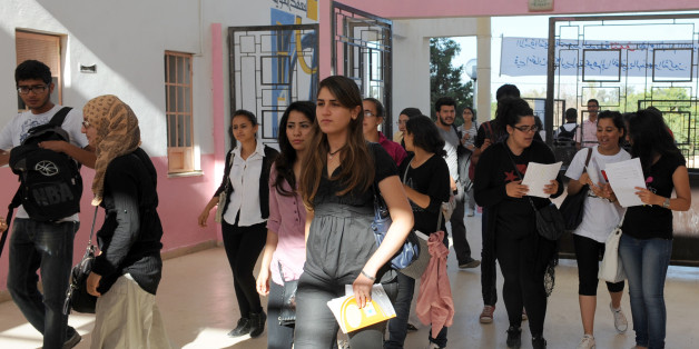 Tunisian students arrive to take the baccalaureat (high school graduation exam) exam on June 6, 2012 at a high school in Tunis. Some 129 181 candidates registered for the main session to be held baccalaureate this year from 6 to 13 June 2012. The average female candidates stood at 57.06% against 42% for boys. The Bachelor 2012 will be marked by the application of an adult aged 64 years and five students who are serving a prison sentence. The exam results will be announced on June 23, 2012. AFP P