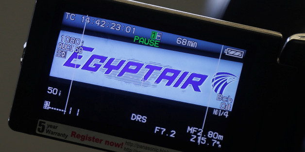 FILE PHOTO - The company logo is displayed on a video camera screen at the Egyptair desk at Charles de Gaulle airport, after an Egyptair flight disappeared from radar during its flight from Paris to Cairo,  in Paris, France, May 19, 2016.  REUTERS/Christian Hartmann/File Photo