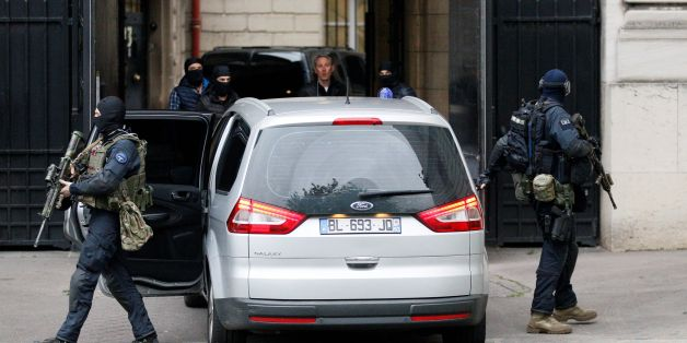 A convoy of French police and members of the National Gendarmerie Intervention Group (GIGN) transporting a surviving member of the group that carried out Paris terror attacks suspect Salah Abdeslam, arrive at courthouse for his first questioning by anti-terror judges in Paris on May 20, 2016 .