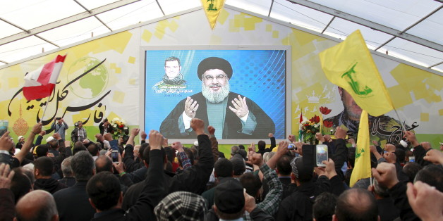 Lebanon's Hezbollah leader Sayyed Hassan Nasrallah addresses his supporters via a screen during a commemoration service marking one week since the death of Ali Fayyad, one of Hezbollah's senior commanders killed fighting alongside Syrian army forces in Syria, in Ansar village, southern Lebanon March 6, 2016. REUTERS/Aziz Taher
