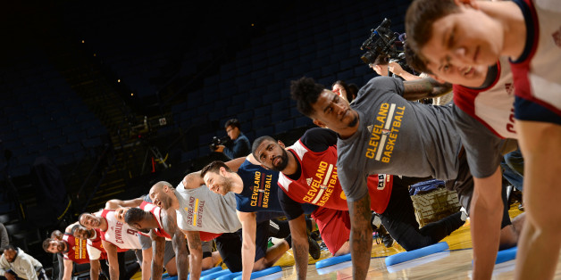 OAKLAND, CA - JUNE 18: The Cleveland Cavaliers stretch during practice and media availability as part of the 2016 NBA Finals on June 18, 2016 at ORACLE Arena in Oakland, California. NOTE TO USER: User expressly acknowledges and agrees that, by downloading and or using this photograph, User is consenting to the terms and conditions of the Getty Images License Agreement. Mandatory Copyright Notice: Copyright 2016 NBAE (Photo by Noah Graham/NBAE via Getty Images)