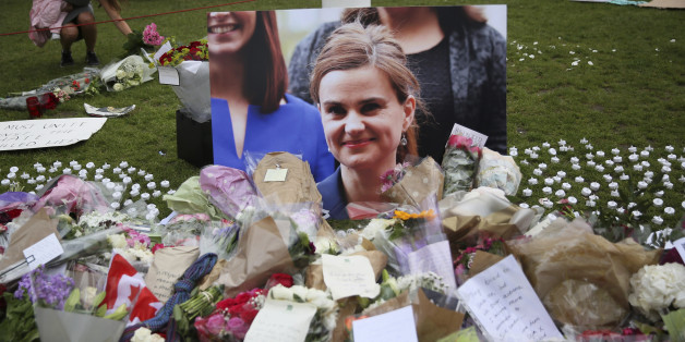 Tributes in memory of murdered Labour Party MP Jo Cox, who was shot dead in Birstall, are left at Parliament Square in London, Britain June 18, 2016. REUTERS/Neil Hall