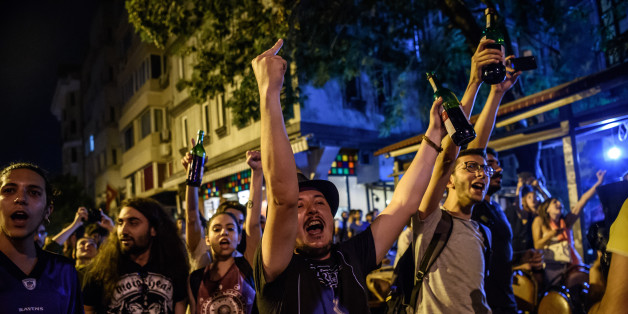 Protester chant slogans against goverment on June 18, 2016 at cihangir district in Istanbul during a demonstration against the islamist attack.  British rock group Radiohead on June 18 condemned 'violent intolerance' after Islamists brutally attacked customers at an Istanbul record store attending an album release party, angered that the event coincided with Ramadan. / AFP / OZAN KOSE        (Photo credit should read OZAN KOSE/AFP/Getty Images)
